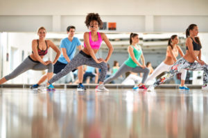 Black curly trainer with group training aerobic